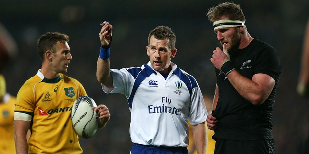 Referee Nigel Owens explains a call to Kieran Read and Nic White during the Bledisloe Cup match. Photo / Getty Images