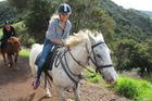 Horseback is a novel way to get around Auckland's Waiheke Island. Photo / Supplied