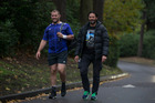 All Blacks prop Owen Franks walks with Willie Apiata at the team training base. Photo / Brett Phibbs