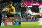 Australia and Argentina clash in the second Rugby World Cup semifinal. Photos / AP and Brett Phibbs