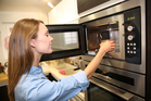 We can relax and use our microwaves without fear. There's no evidence microwave ovens are harmful. Photo / iStock