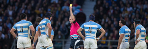 Referee Wayne Barnes shows the yellow card to Argentina lock Tomas Lavanini. Photo / Brett Phibbs