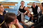 GOOD MAHI: Musician and presenter Ria Hall talks to Turakina students Indi Locke, Teresa Eggins-Pickering, Ella Lyon and Lani Hirini ahead of her workshop at the school yesterday.PHOTO/STUART MUNRO