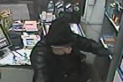 A CCTV photograph of a robber with a pistol at the Mobil service station in Stortford Lodge in Hastings.