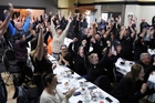 CROWD GOES NUTS: Patrons at Stellar Restaurant & Bar in Wanganui cheer on Beauden Barrett's try that sealed the deal for the All Blacks in the Rugby World Cup decider yesterday morning. More pictures: Page 3. PHOTOS/STUART MUNRO