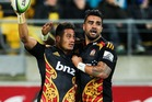 Augustine Pulu of the Chiefs is congratulated on his try by Liam Messam. Photo / Getty Images.