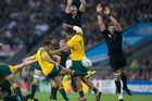Brodie Retallick and Kieran Read attempt to charge down a Will Genia kick. Photo / Brett Phibbs