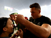 Sonny Bill Williams of New Zealand hands his medal to a young fan after winning the 2015 Rugby World Cup Final match. Photo / Getty Images