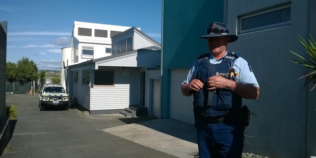 A police guard outside a property on The Esplanade, Westshore. Photo / Hawke's Bay Today