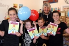 CELEBRATE BOOKS: Paiges owner Lesley Stead with (from left) Paige Stead, 9, Brooke Rasmussen, 6, Bella Stead, 7, and Mya Rasmussen, 10, who are thrilled with their books and balloons.