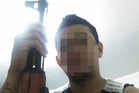 The man, believed to be an Aucklander, poses with rifle in a photo posted on Facebook. Photo / Supplied