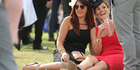 Women have a drink at Flemington racecourse on Melbourne Cup day. Photo / Getty Images