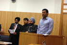 Satnam Singh, second from left, Jaswinder Singh Sangha on the right in the High Court at Nelson. Photo / John Weekes