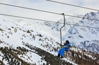 Skiers enjoy stunning panoramic views from the cableway at the ski resort in Soelden. Photo / 123RF