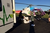INJURED: Paramedics help treat a Waihi man, seriously injured after he crashed into a bull while riding a motorbike.PHOTO/SUPPLIED