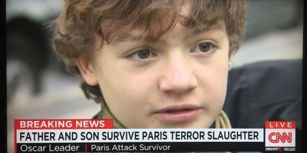 Oscar Leader became separated from his father while they fled the theatre, but were reunited on the streets of Paris shortly after. Photo / CNN screenshot