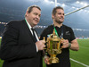 All Blacks head coach Steve Hansen and captain Richie McCaw with the Webb Ellis Cup. Photo / Brett Phibbs