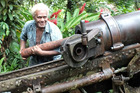 Anderson Dua demonstrates how to load a shell at the Vilu War Museum just outside Honiara. Picture / Gillian Vine