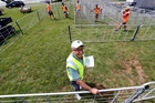 Malcolm McKerrow helps set up the calf and sheep judging area ahead of this weekend's A&P Summer Show. Photo / John Stone