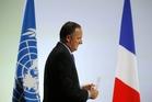 Climate commitments by John Key (below left) in Paris earned New Zealand a
