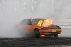 SIZZLING SATURDAY: Philip Morris makes a fiery statement in his 1990 V6 Commodore as the bonnet of his car burst into flames. PHOTO/John Faulkner