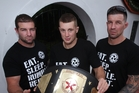 BJ Bland (centre) shows off his MMA national welterweight belt with Chris eaton (left) and Kim Eaton. PHOTO/Paul Taylor
