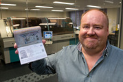 Peter Town with his new 10-year passport hot off the press at the Department of Internal Affairs logistical support centre in Wellington. Photo / Mark Mitchell