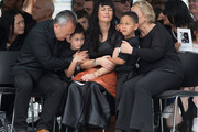 Jonah Lomu's wife Nadene Lomu with sons Dhyrelle and Brayley are supported by her parents at Eden Park. Photo / Brett Phibbs