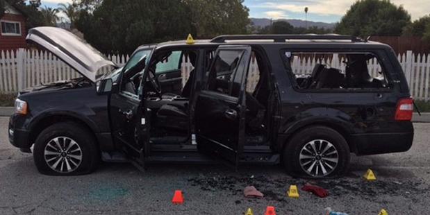 A vehicle at the scene of a shootout in San Bernardino. Photo / AP