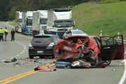 The collision 20km south of Oamaru on State Highway 1 claimed the motorcyclist's life and left six other people with injuries. Photo / Otago Daily Times