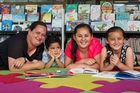 Michelle Timoti-Hohaia and her children Hemi, 4, Rita, 9, and Arotia, 7, are ready to read. Photo / Kellie Blizard