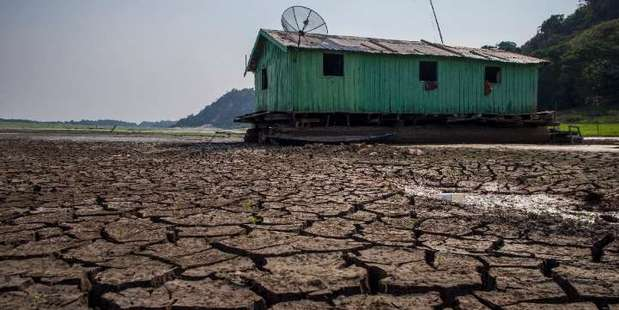 Cracked soil sits on the bed of the Aleixo Lake in the Amazonas, Brazil, on October 23, 2015 as the region suffers a severe drought. Photo / AFP