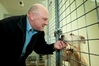 John Payne, pictured visiting the Hastings dog pound earlier this year. Photo / File