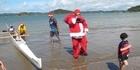Santa arrives at Waitangi - by waka