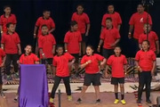 Students from Favona Primary in Mangere bring happiness to crowds at Eden Park.
