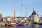 Heritage buildings and classic sailing boats in Hoorn Harbour. Photo / Liz Light