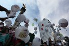 Children attach letters to balloons for the feast of the Three Kings, asking for the 43 missing colleges students, in Mexico City. Photo / AP