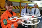 COMMUNITY HELP: Fire force controller Kirsty Chaffe with Rangitikei Masonic Lodge secretary Brian Short and master Graeme Hill whose organisation has donated $1350 towards the cost of a new drone.PHOTO/STUART MUNRO