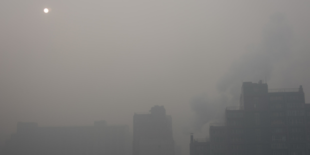 A residence community is blanked by smog on November 30, 2015 in Beijing, China. Photo / Getty