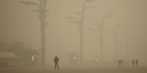 Tourists visit the Olympic Park during a heavy smog. Photo / Getty