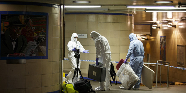 Police officers and crime scene investigators at the Tube station. The UK is currently on high alert for terrorist attacks. Photo / Getty Images
