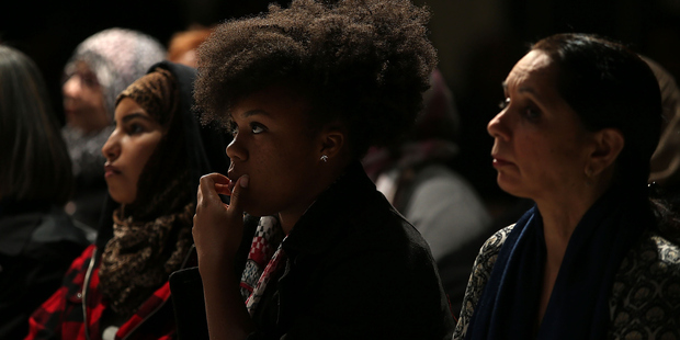 Mourners at a vigil for victims of the mass shooting. Photo / Getty Images