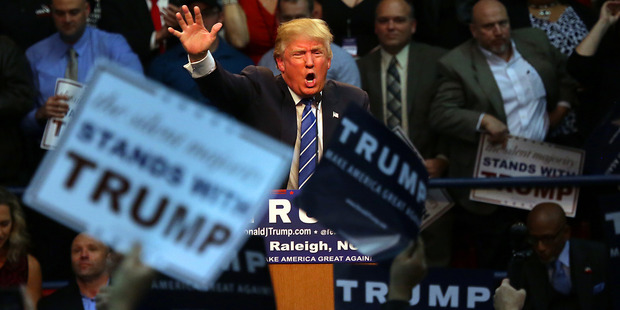 Republican presidential candidate Donald Trump energizes the crowd during a campaign rally at Dorton Arena in Raleigh. Photo / AP
