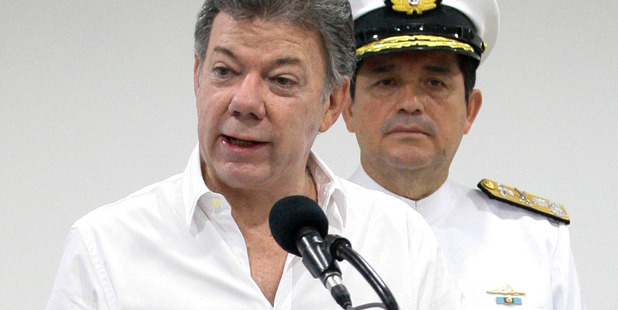Colombia's President Juan Manuel Santos talks to the media during a press conference in Cartagena, Colombia. Photo / AP