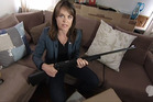 TV3 journalist Heather du Plessis-Allan displays a .22 calibre sporting rifle that she purchased via the internet using fake documentation on TV3's Story programme. Photo / Supplied