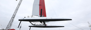 Team New Zealand mount the wing sail to their new catamaran before testing in the Waitmata Harbour. Photo / Greg Bowker