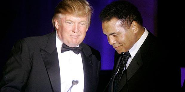 Donald Trump, left, accepts his Muhammad Ali award from Ali at Muhammad Ali's Celebrity Fight Night XIII. Photo / AP