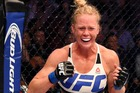 Holly Holm celebrates her second round KO win over Ronda Rousey at UFC 193 in Melbourne last month. Photo/Getty.