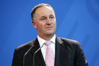 John Key is facing criticism for participating, perhaps unwittingly, in a distasteful rape joke on live radio. Photo / Getty