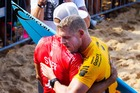 Mick Fanning and Kelly Slater embrace. Photo / Getty Images